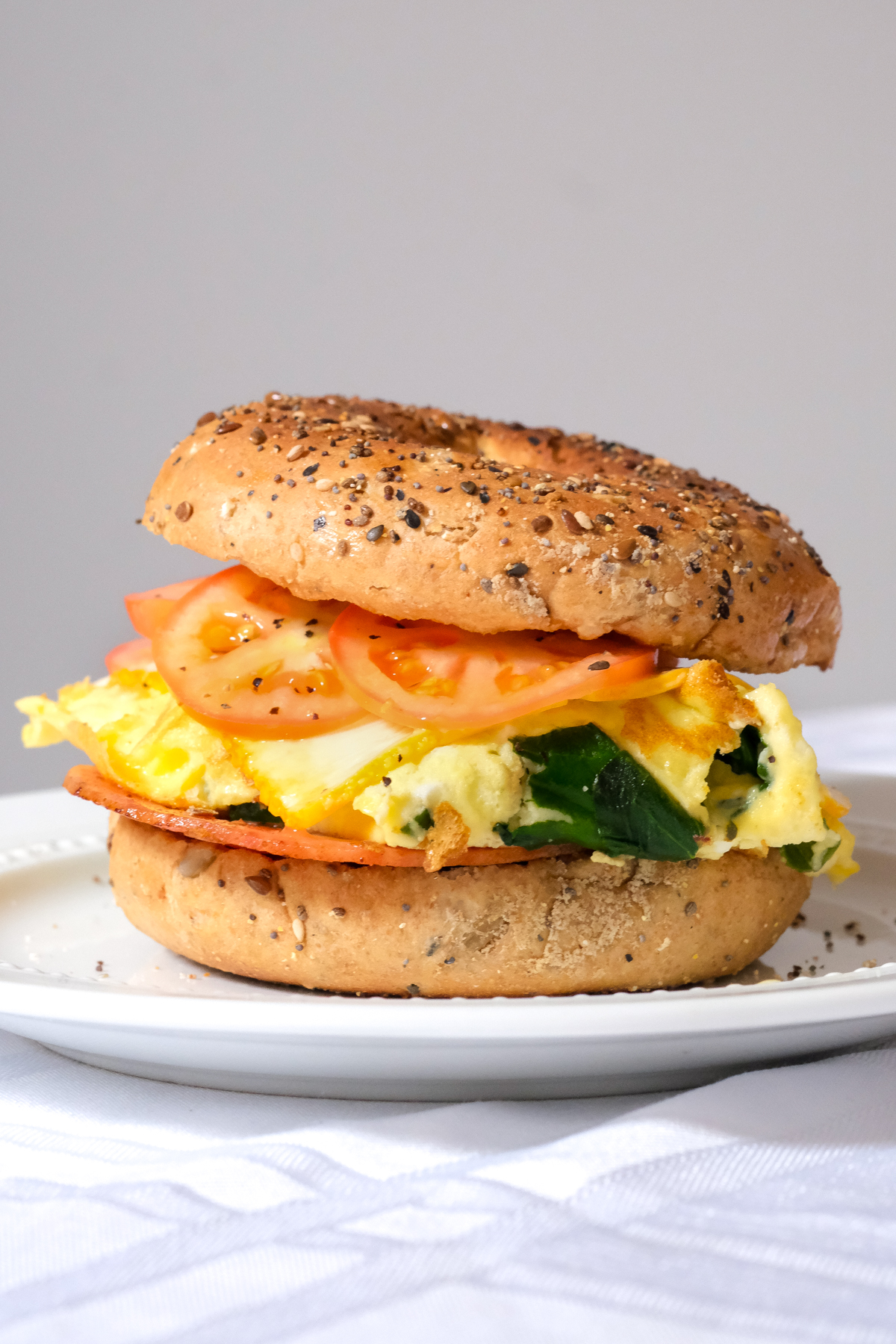 spinach omelette breakfast sandwich on a bagel