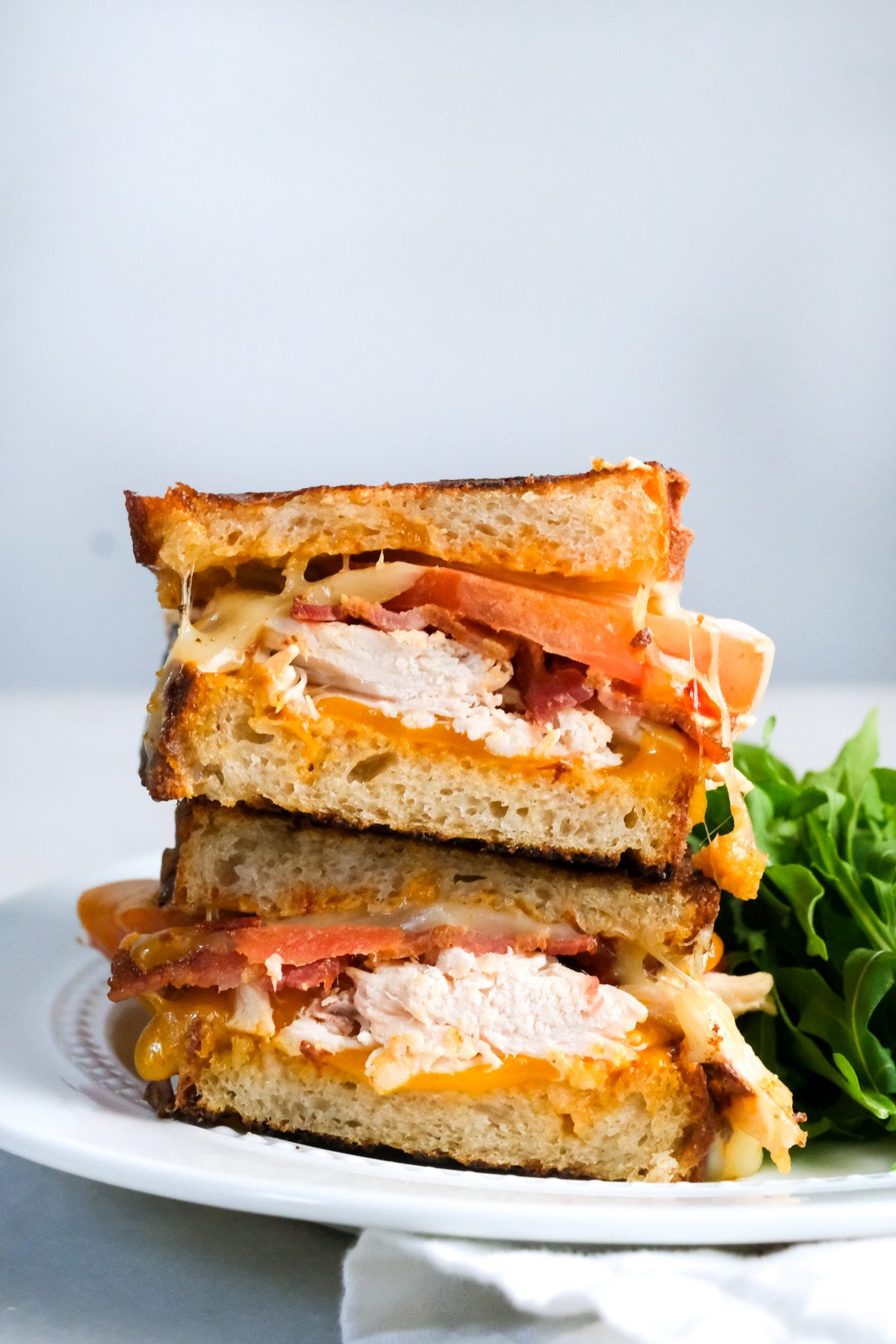 chipotle chicken bacon toastie with salad