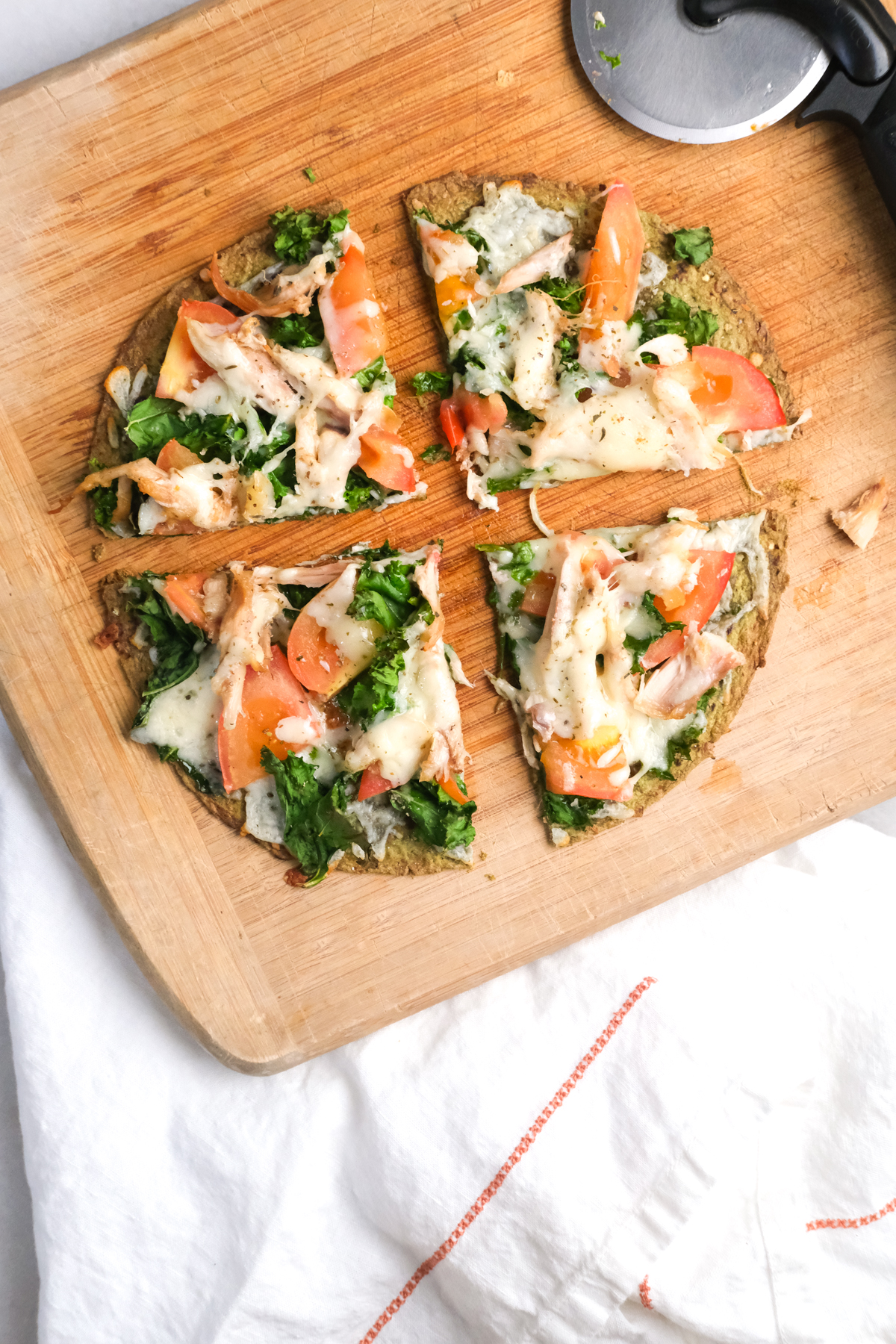slices of a lunch chicken flatbread with vegetables