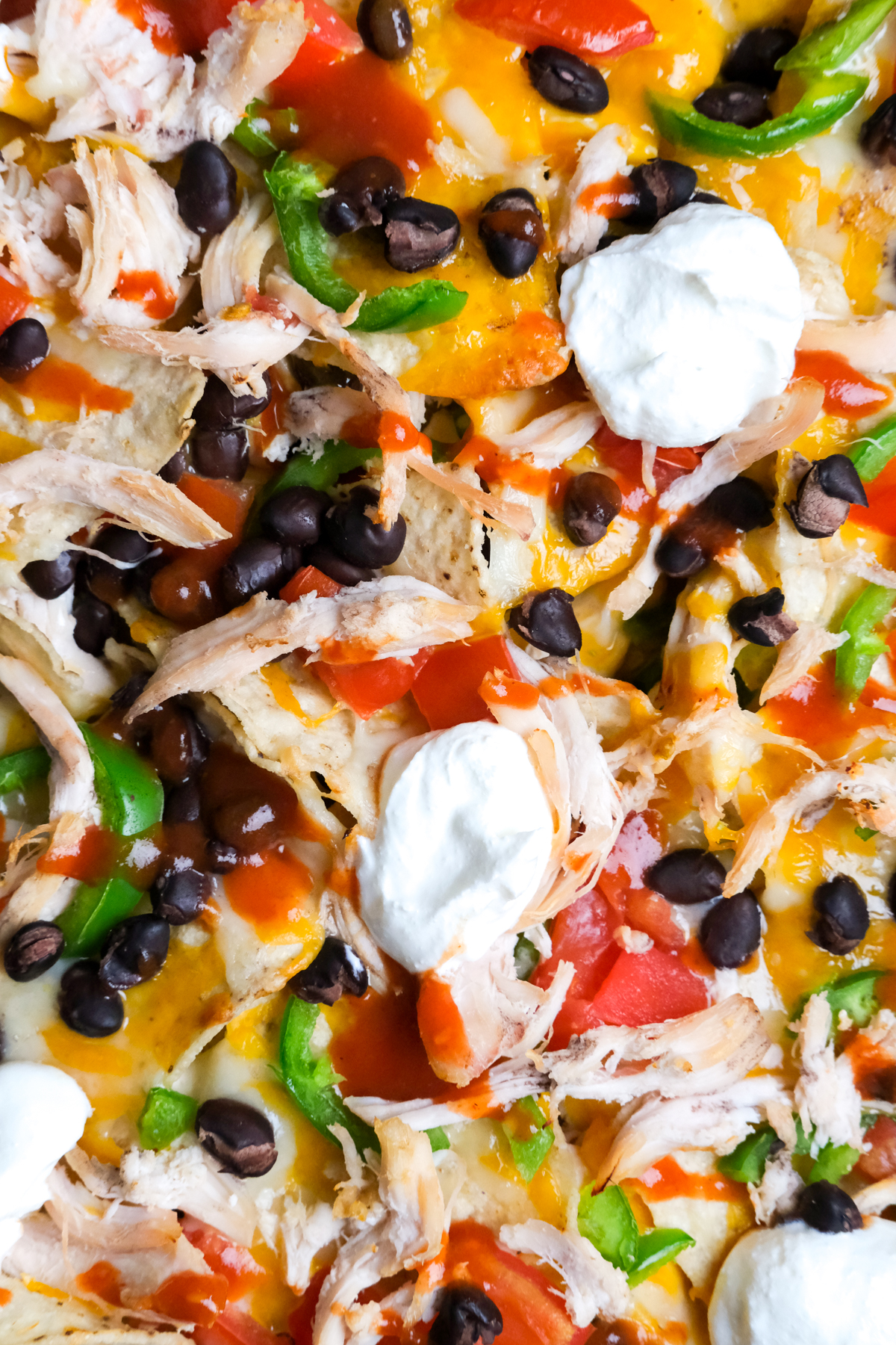 close up of fixings on chicken nachos