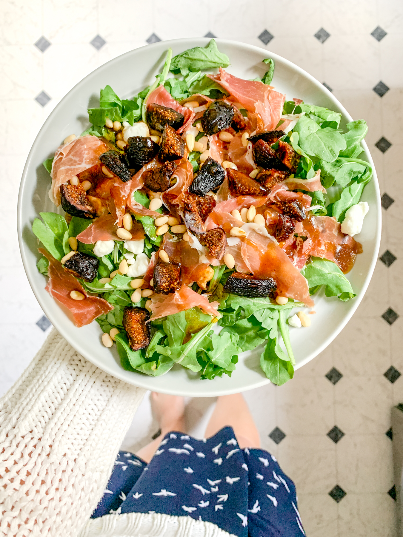 fig prosciutto salad on a plate