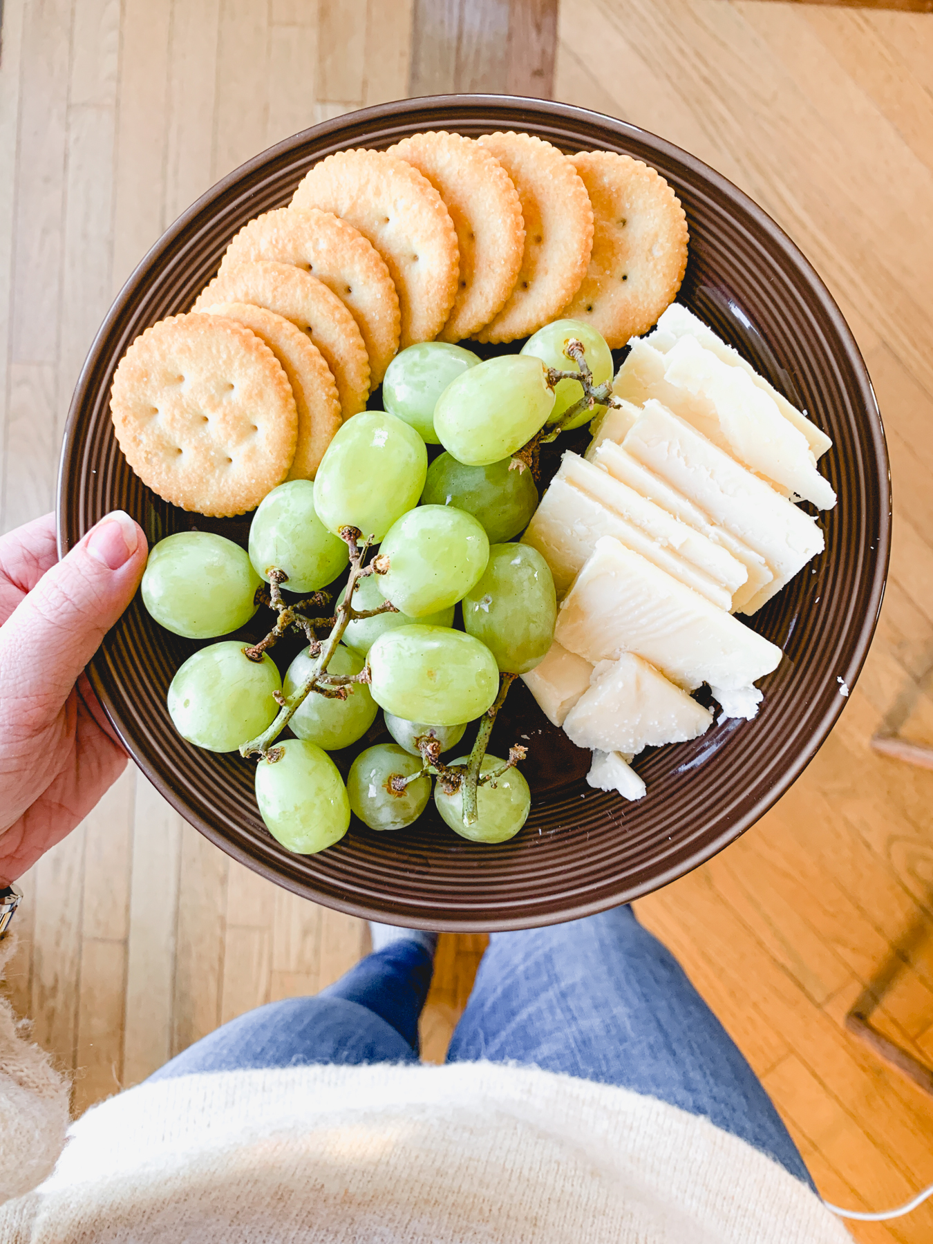snack plate with cheese crackers and grapes
