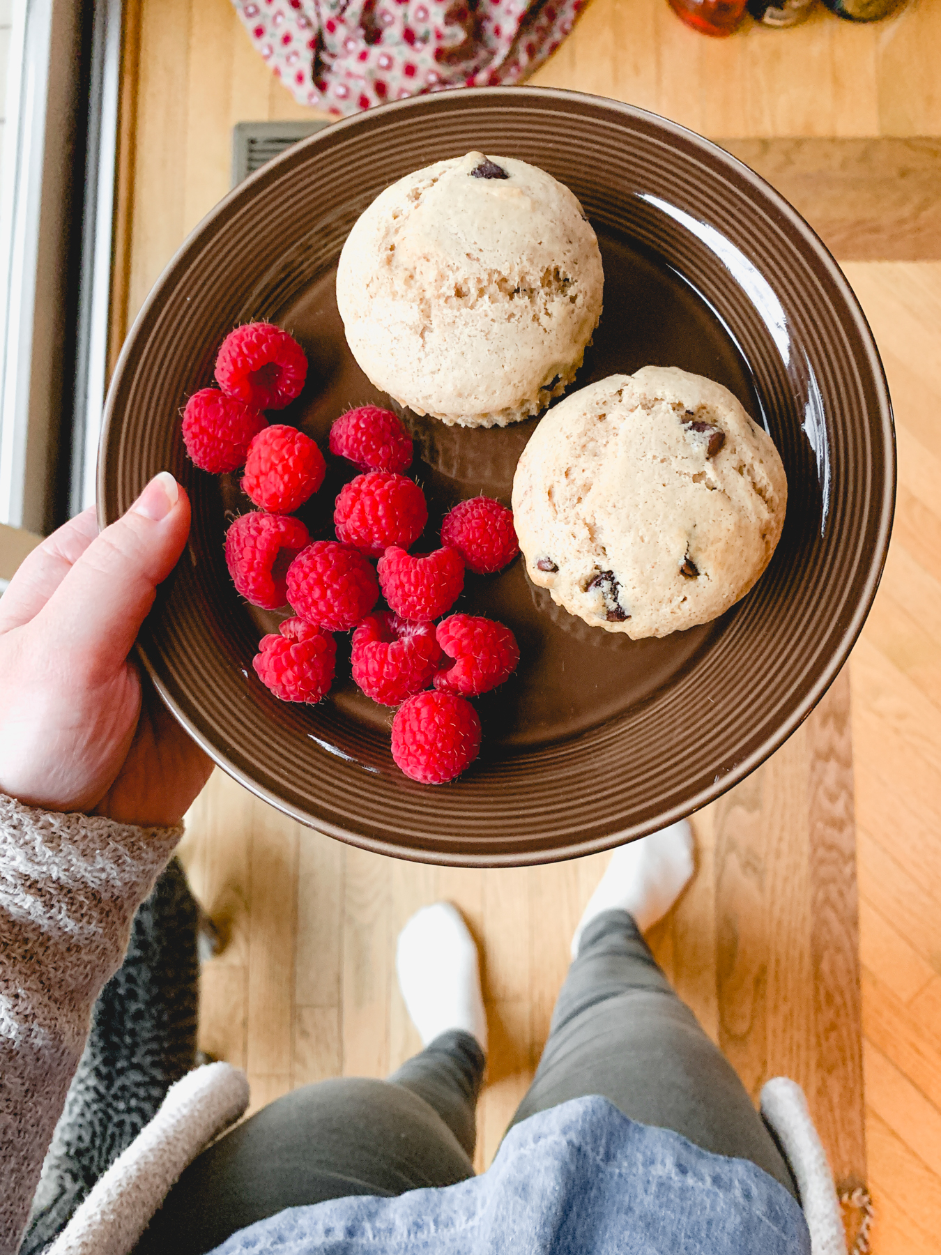sourdough chocolate chip muffins with berries on a plate