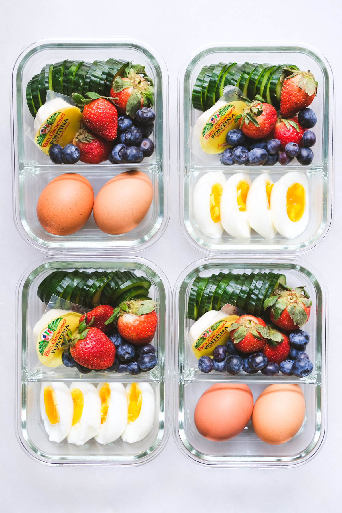 lunch meal prep with eggs cheese fruit and cucumbers