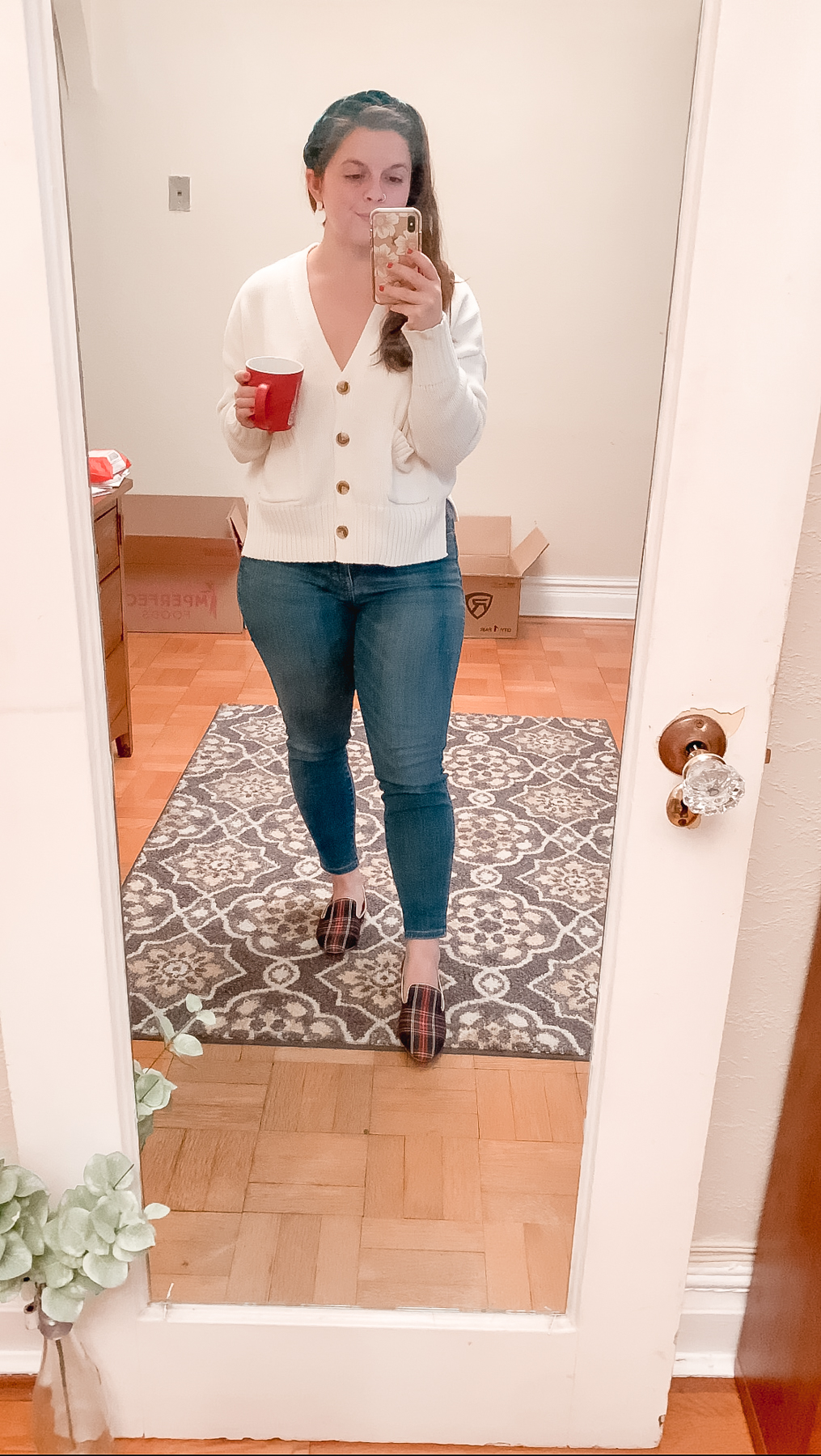 white sweater and jeans outfit while working from home