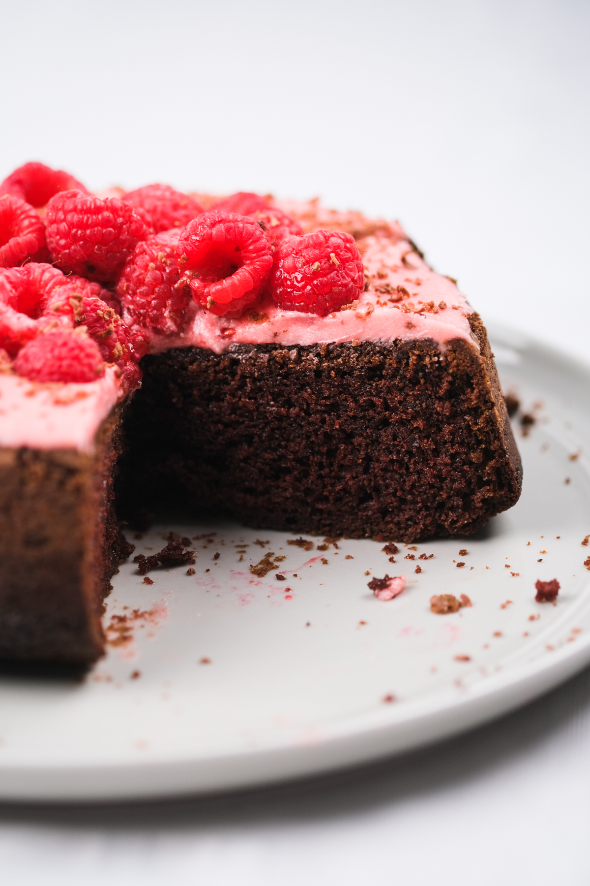 chocolate raspberry cake with pink frosting and chocolate shavings