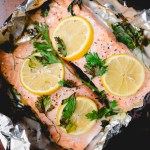 baked salmon with lemon and parsley in tin foil