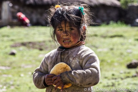 Little Girl with Bread, Andes, Peru