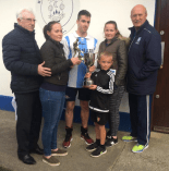 Jonathan Hanafin receives the player-of-the-tournement award from Theresa and Marie Cahillane with Athletic officials Don O'Donoghue and Tom Tobin