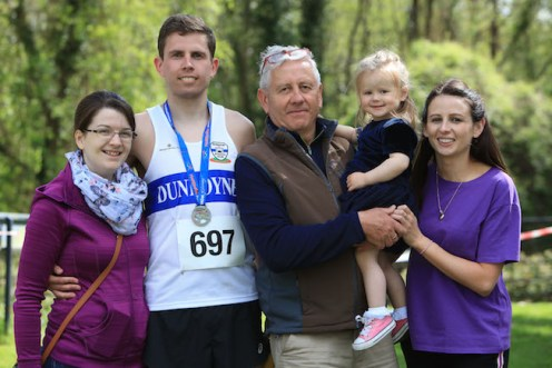 Cian O'Sullivan, with his family, after competing in this year's Lakes of Killarney Marathon