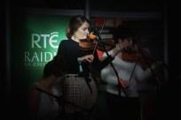 Áine Ní Chronín performing on fiddle