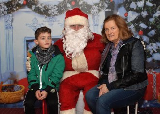 Eric Corcoran and Mary O'Connor meeting  Santa