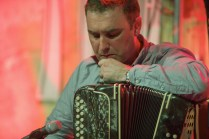 Renowned accordion player Paudie O'Connor listening to an air performed by Niamh Ní Charra