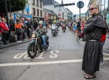 Hell's Angels: Br Joel from the Franciscan Friary, Killarney watching the spectacular parade of bikes through the streets