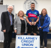 Tim Jones receives the cup from Heleh Courtney Power of Killarney Credit Union with Killarney Athletic AFC officials Don O'Donoghue and Colette Casey