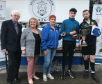 Player of the Tournament Gary Keane, captain of The Fáilte Legends, received the coveted Kieran Cahillane Memorial Perpetual Cup from Jason Cahillane with Don O'Donoghue and Geraldine Nagle of Killarney Athletic AFC and Helen Courtney Power, Killarney Credit Union