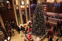 A scene from the lighting of the Christmas tree and visit of Santa Claus at the Brehon Hotel