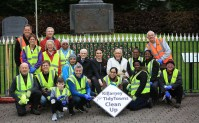 John Coffey (back, centre right) supporting the Killarney Tidy Towns weekly clean up