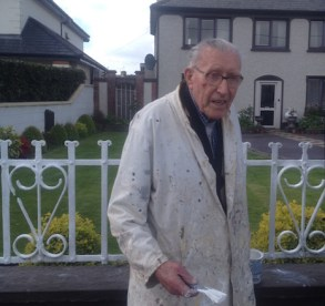 John is his familiar white work coat painting the railings at Brandon House on Lewis Road