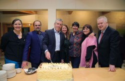 Peter cutting his retirement cake at the launch with staff members of Killarney House, Diane Donovan, Horracio Prieto, Bríd Colhoun, Rachael Kavanagh, Nikki Wessell, and Pat Dawson, manager