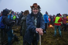 Celebrating the Solstice: Johnny 'The Rock' O'Brien, from Glenflesk, on the summit of the Paps of Anú