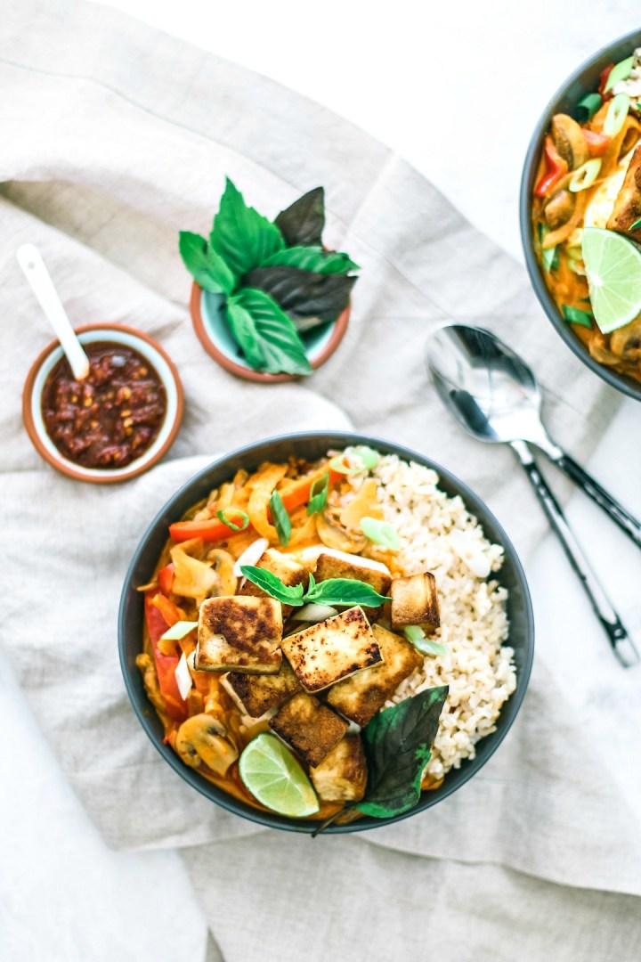 Bowl of red curry with tofu.