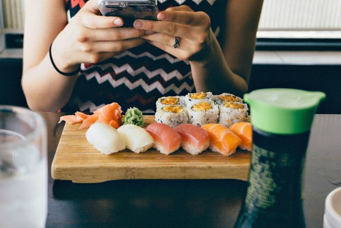 Serving board with sushi arrangement.