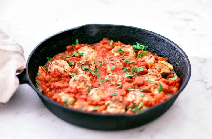 Skillet with turkey meatballs and marinara sauce.