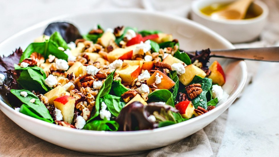 Close up of Apple Pecan and Farro Salad in a large bowl.