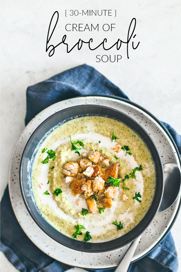 Bowl of cream of broccoli soup garnished with croutons.