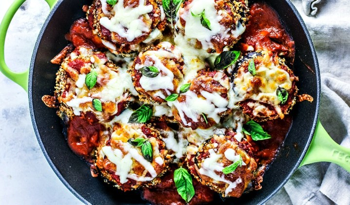 Saucy and cheesy eggplant parmesan in a skillet.