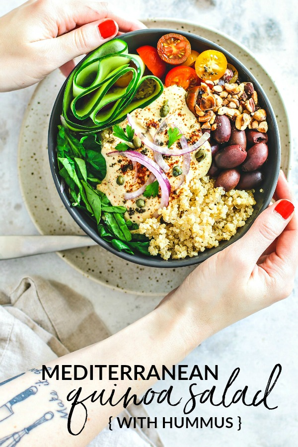 Pinnable Image: Hands holding bowl of Mediterranean Quinoa Salad
