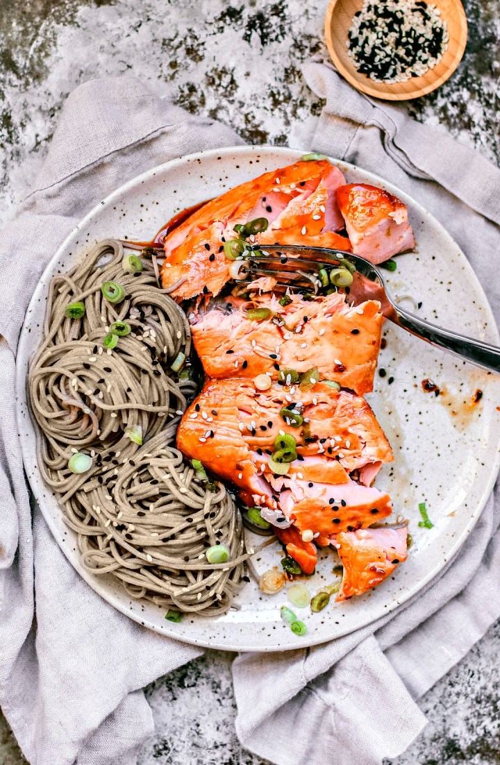 Plated salmon flaked with fork.