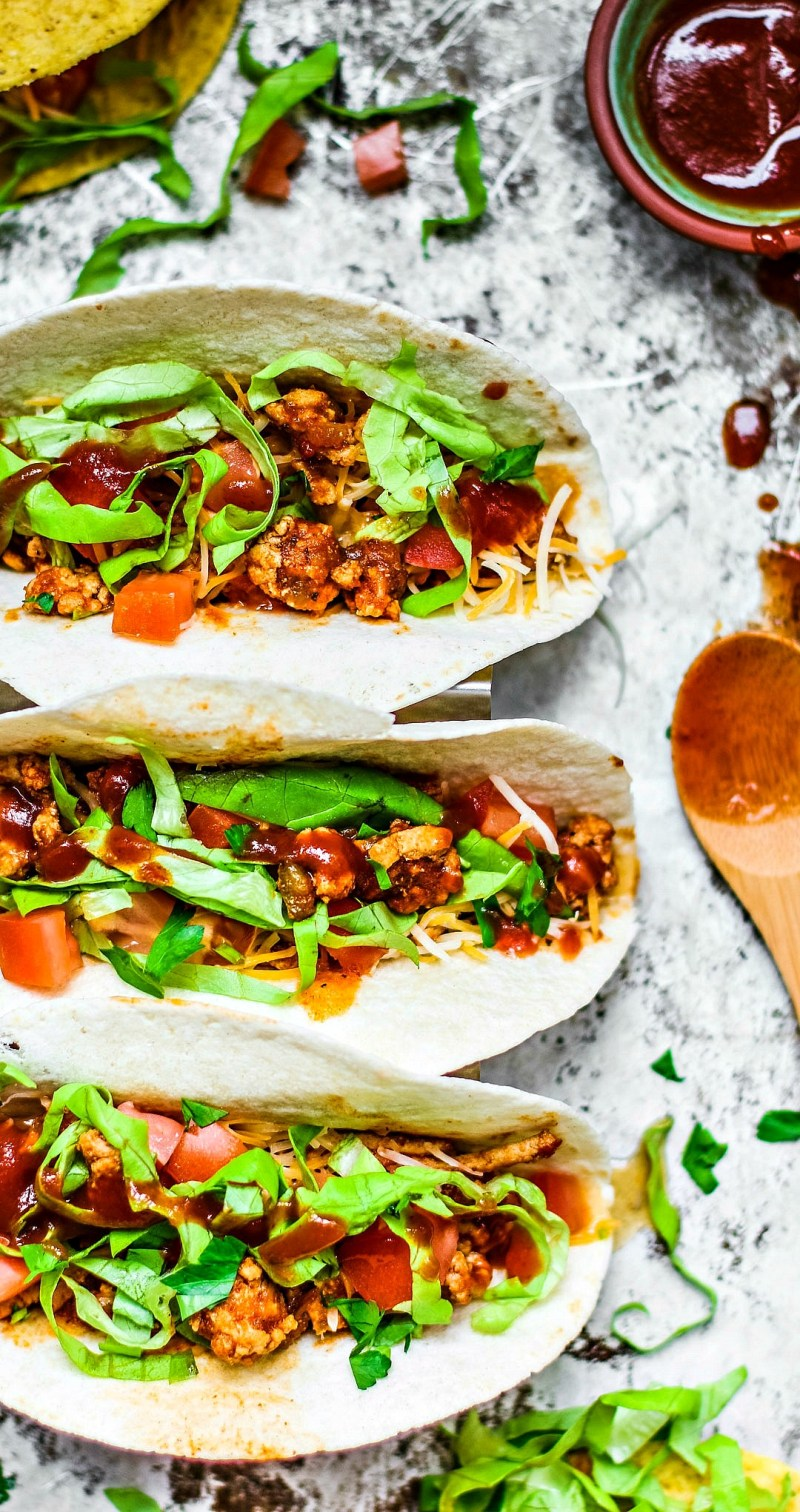 Instant Pot Ground Turkey Tacos drizzled with taco sauce.