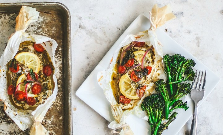 Baked flounder in parchment, cooked and plated.