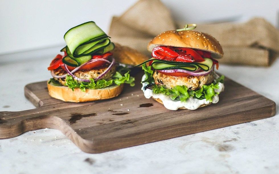 Greek Turkey Burgers stacked with fresh toppings.