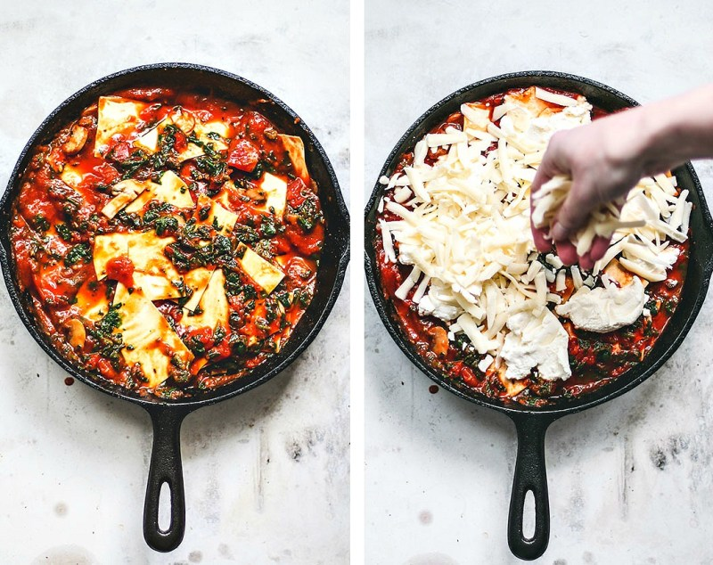 Skillet prep with noodles and cheese being sprinkled on top.