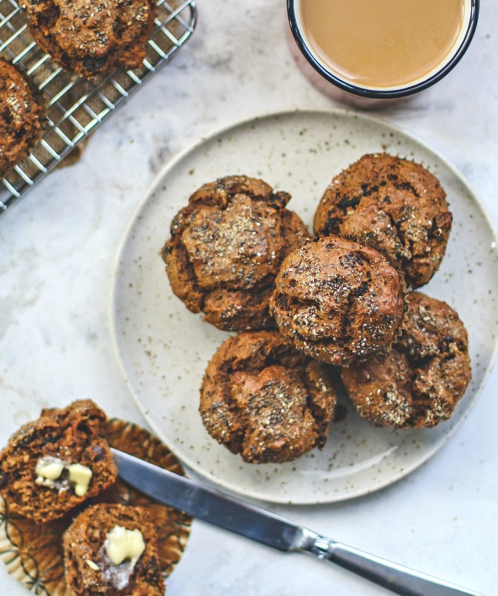 Plate full of muffins with coffee.