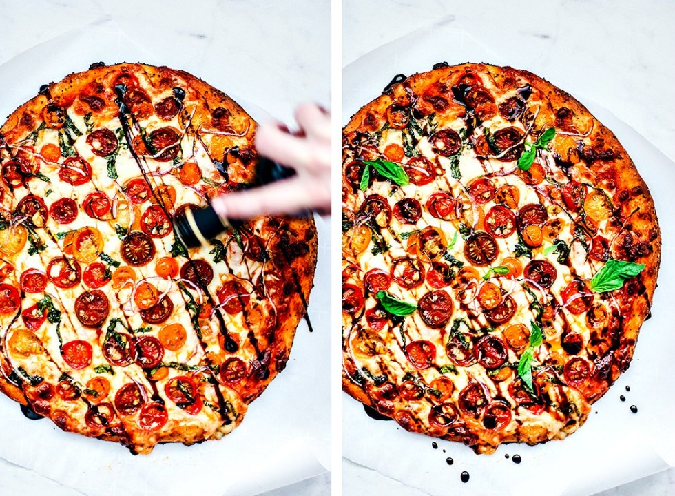 Pizza being drizzled with balsamic/pizza drizzled with balsamic with fresh basil garnish.