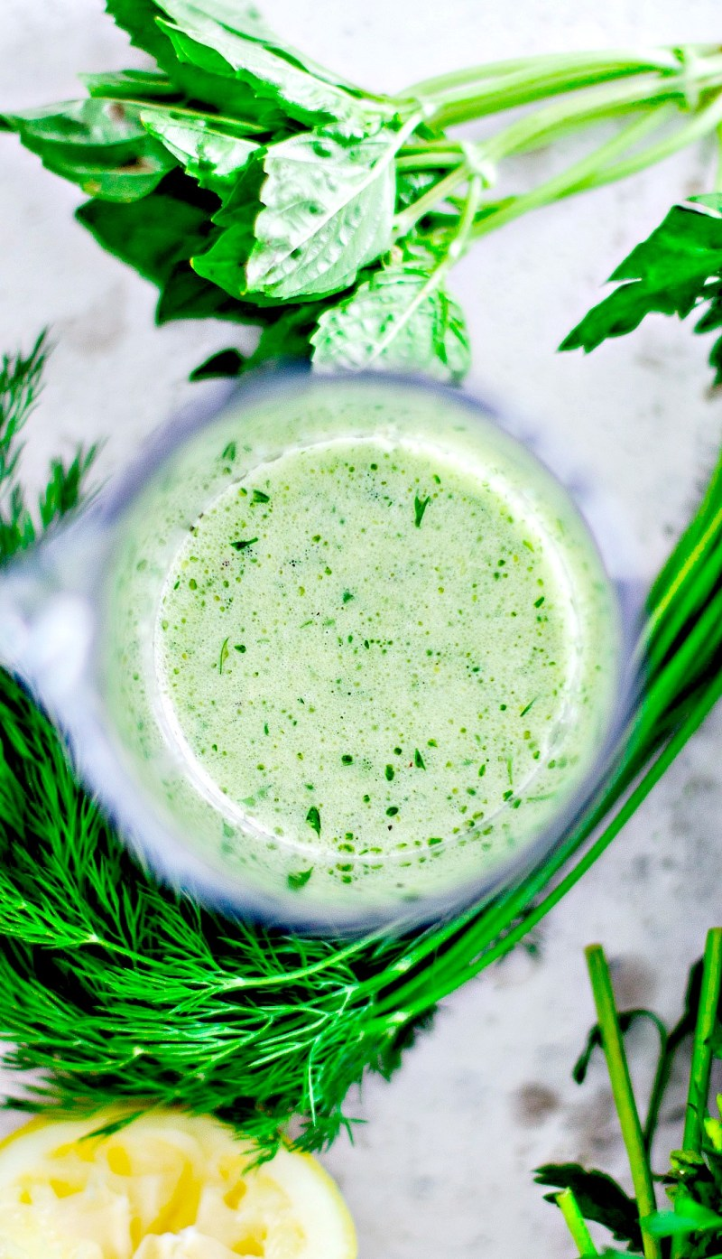 Close up of lemon and herb dressing.