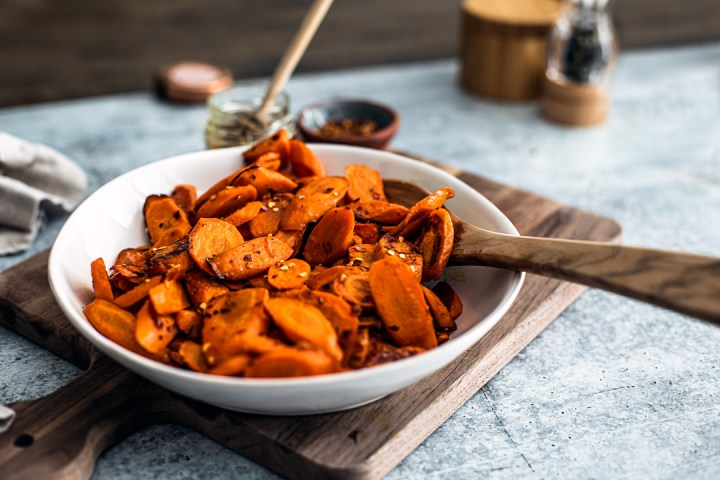 Bowl of hot honey roasted carrots.