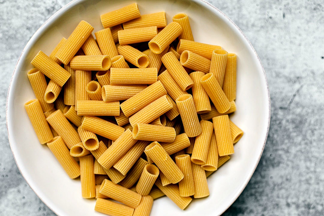 Bowl of uncooked rigatoni.