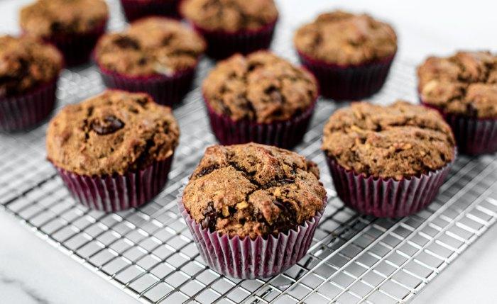 Side shot of muffins on cooling rack.