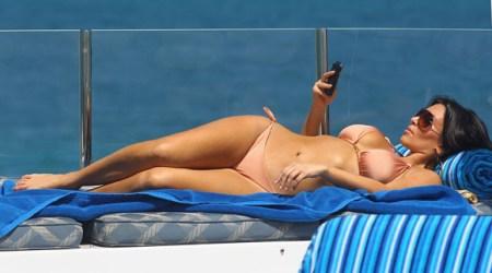 Kim Kardashina in a bikini with her Crackberry, er, Blackberry