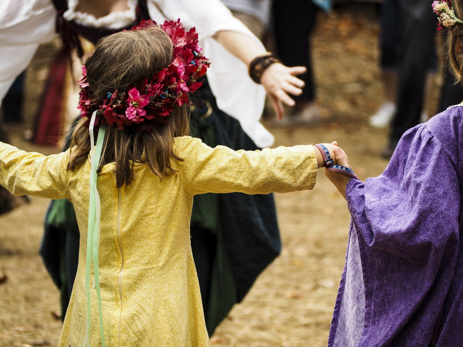 Girl Participating in Maypole Dance at Festival