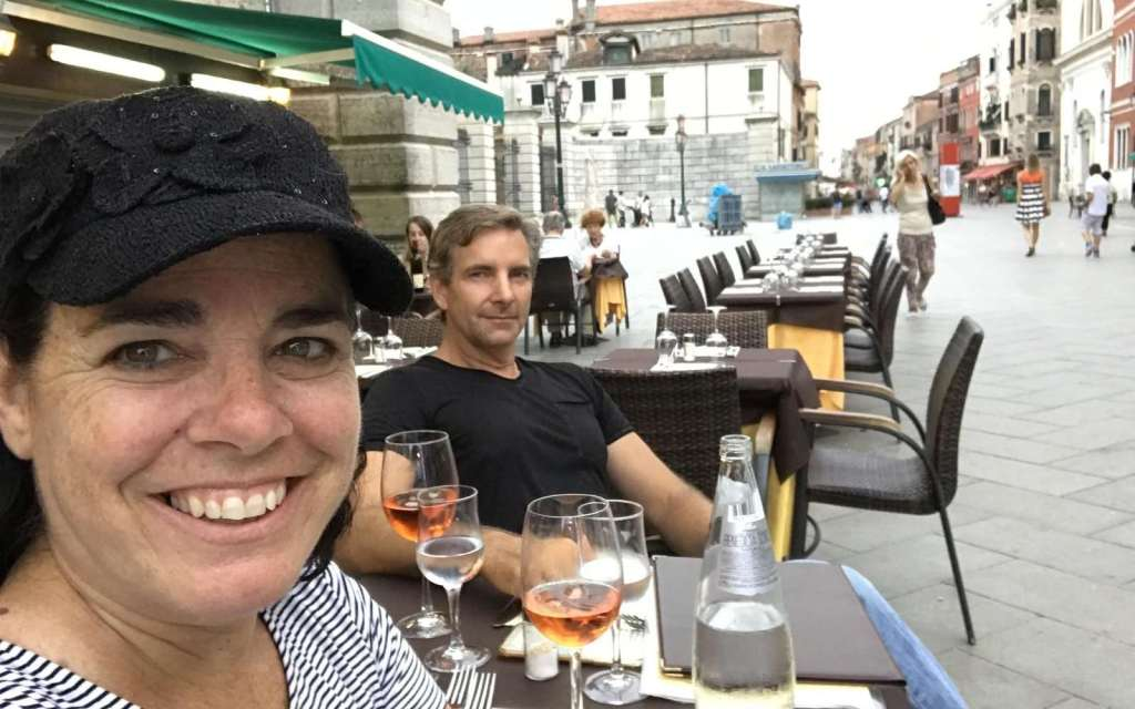Kim and Way, full-time travel vloggers, having lunch in Venice, Italy
