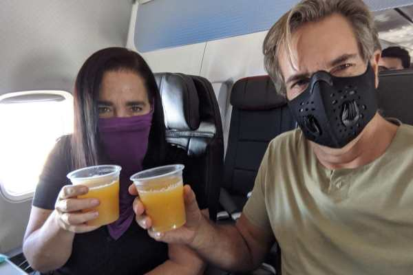 First class mimosas and masks on American Airlines