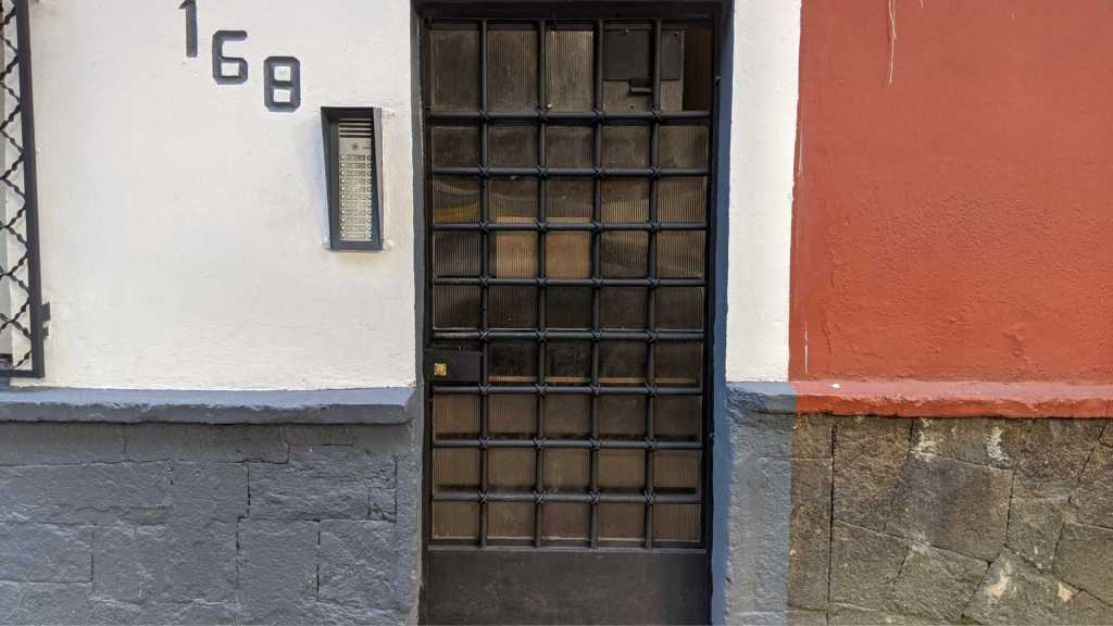 Unmarked door to the apartment building, Mexico City, Mexico