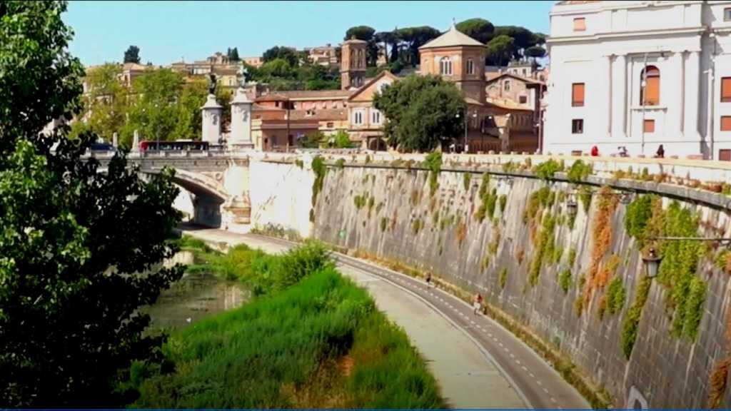 The wall and bike path adjacent to the Tiber River in Rome, Italy