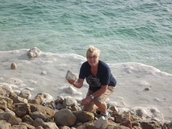 Mom holding a chunk of salt from the Dead Sea